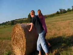 Teens Rolling In The Hay