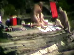 Mature threesome outdoor caught by voyeur