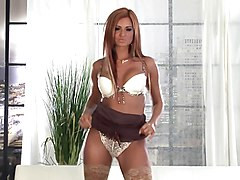 Hot redhead lingerie tease in sheer stockings