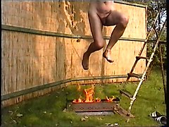 Naked male slave tortured by fire