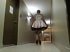 sissy ray in pink sissy dress in hotel hallway