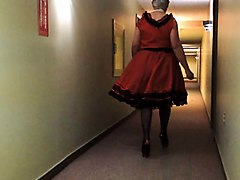sissy ray in red sissy dress in hotel hallway