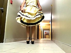 sissy ray in yellow dress in hotel hallway