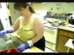chubby girl dish washing in rubber gloves 1