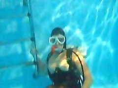 scuba mistress in high heels underwater