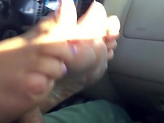 quick car footjob with a very happy ending