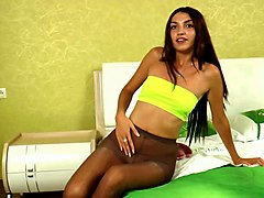 fine redhead sexy russian girl in the bedroom undresses on poses in nylons